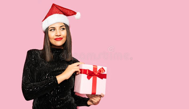 Beautiful Brunette in Black with Christmas Celebration Hat. Gift Concept royalty free stock images