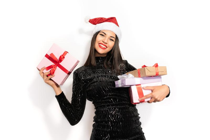 Beautiful Brunette in Black with Christmas Celebration Hat. Gift Concept royalty free stock image