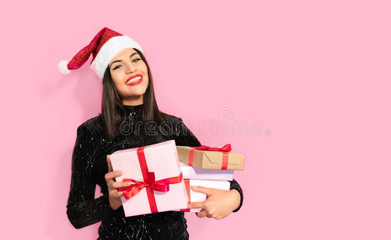 Beautiful Brunette in Black with Christmas Celebration Hat. Gift Concept stock images