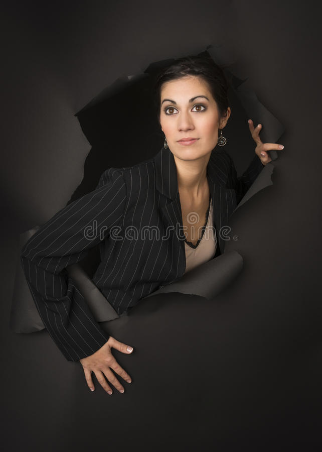 Beautiful Brunette Business Woman Breaks Through Tearing Hole royalty free stock image