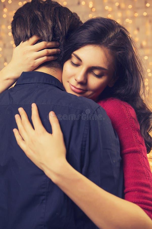 Beautiful brunette caucasian romantic loving couple in cozy warm stock image