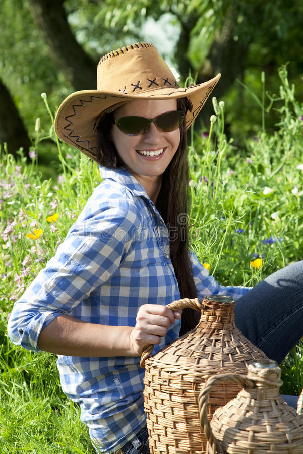 Beautiful brunette cowgirl royalty free stock image