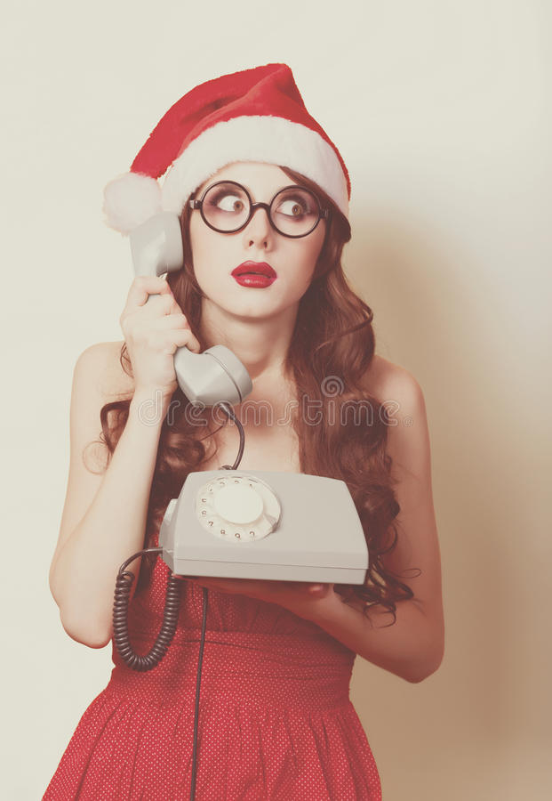 Beautiful brunette girl in christmas hat stock photography