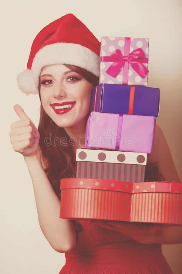 Beautiful brunette girl in christmas hat royalty free stock photography