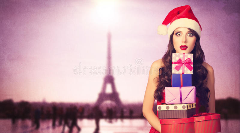 Beautiful brunette girl in christmas hat royalty free stock image