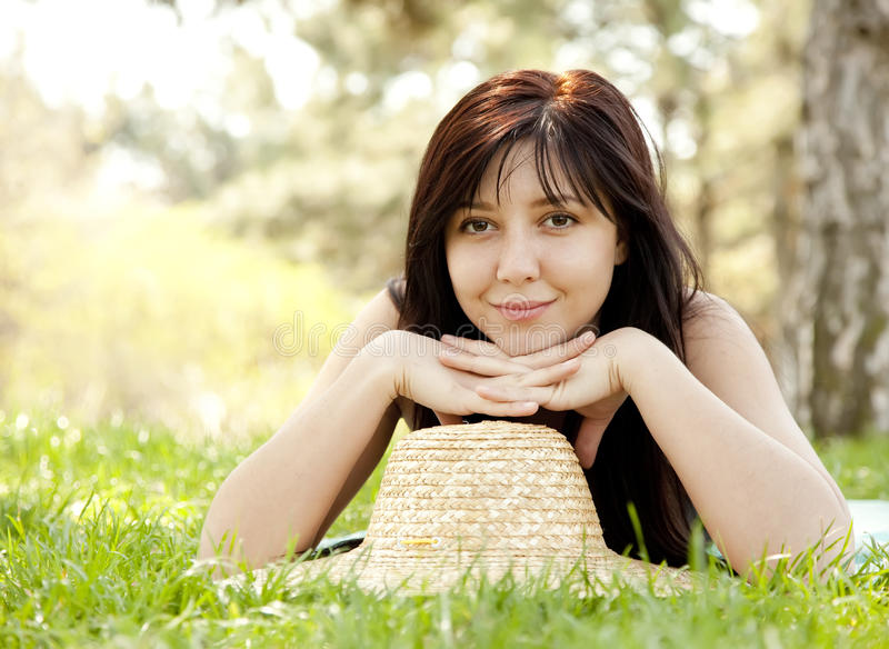 Beautiful brunette girl in hat at the park. stock image