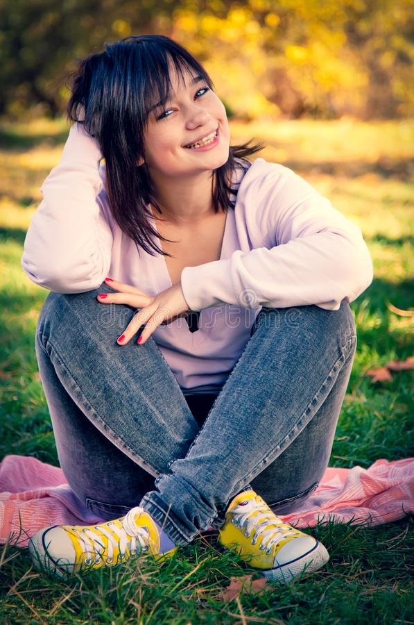 Beautiful brunette girl at the park. stock images