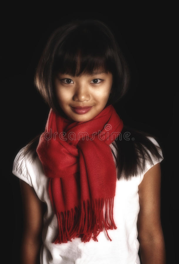 Beautiful brunette girl in a red scarf around his neck royalty free stock images