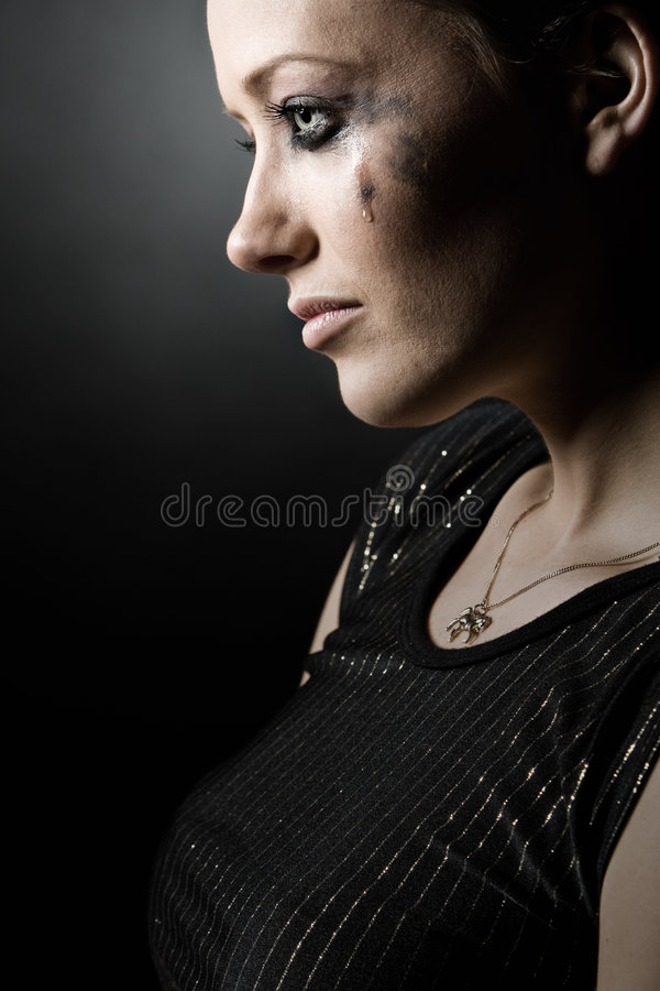 Beautiful Brunette Girl with a Tear stock photography