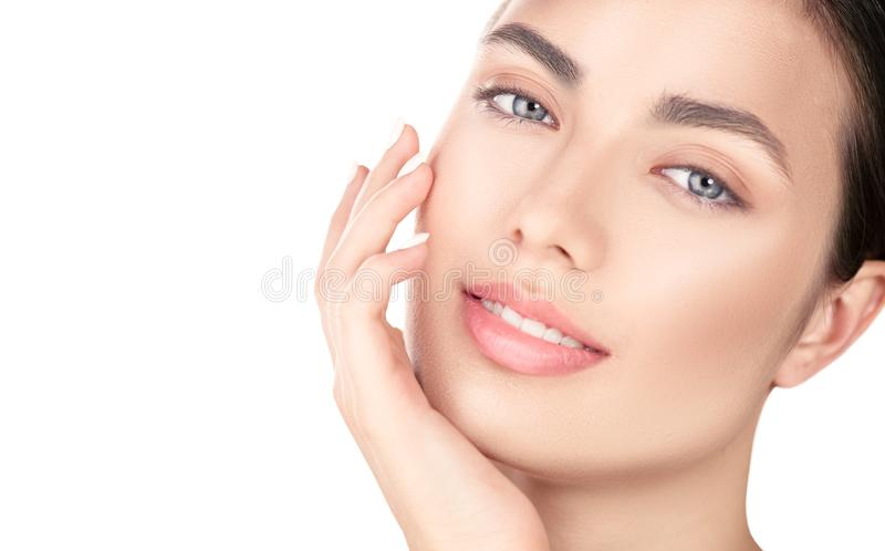 Beautiful brunette girl touching her face. Perfect fresh skin. Beauty portrait isolated on white background. Youth and skincare co. Ncept, cleansing stock photography
