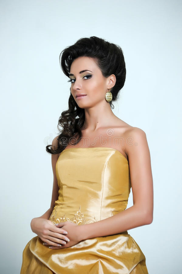 Free Beautiful Brunette In A Golden Retro Dress Royalty Free Stock Photos - 29226678