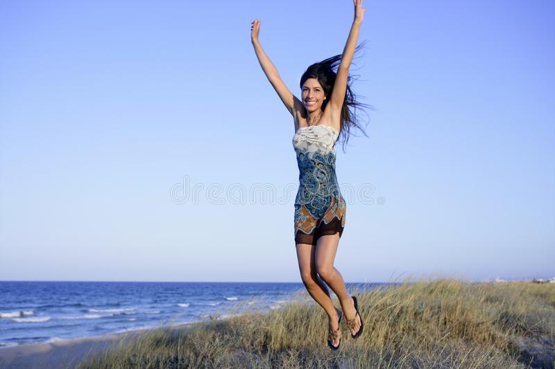 Download Beautiful Brunette Jumping In The Beach Stock Image - Image: 10164527
