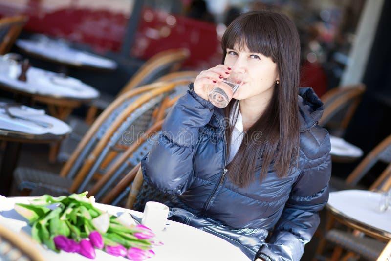 Beautiful brunette lady drinking water stock photo
