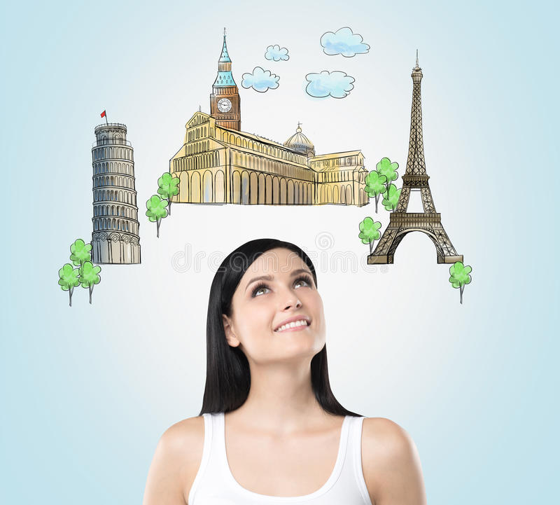 A beautiful brunette is looking up by dreaming about the visiting of the most famous european cities. The concept of tourism and s stock illustration