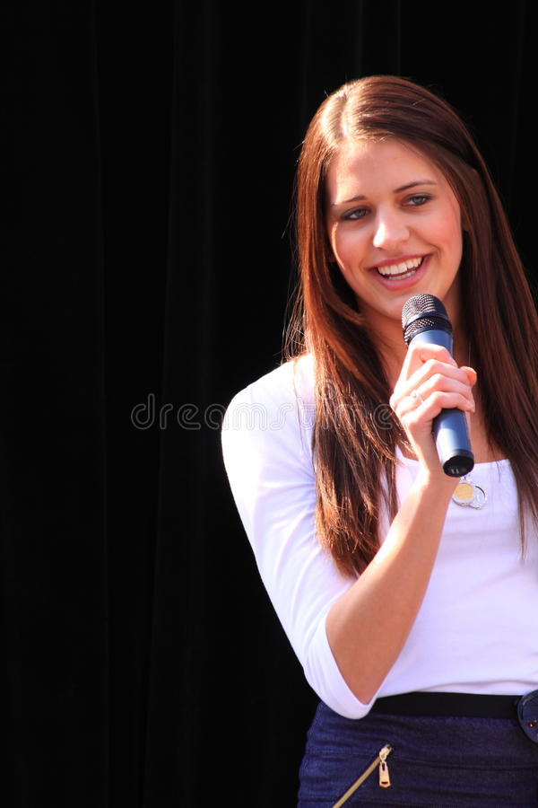Beautiful brunette with microphone royalty free stock images