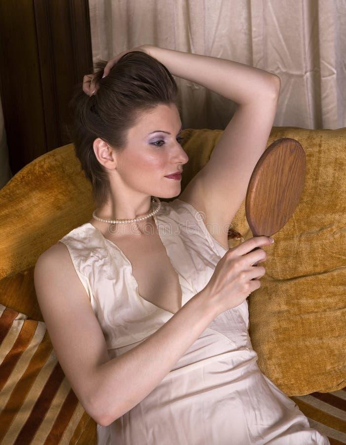 Beautiful Brunette Mirror Stock Photography