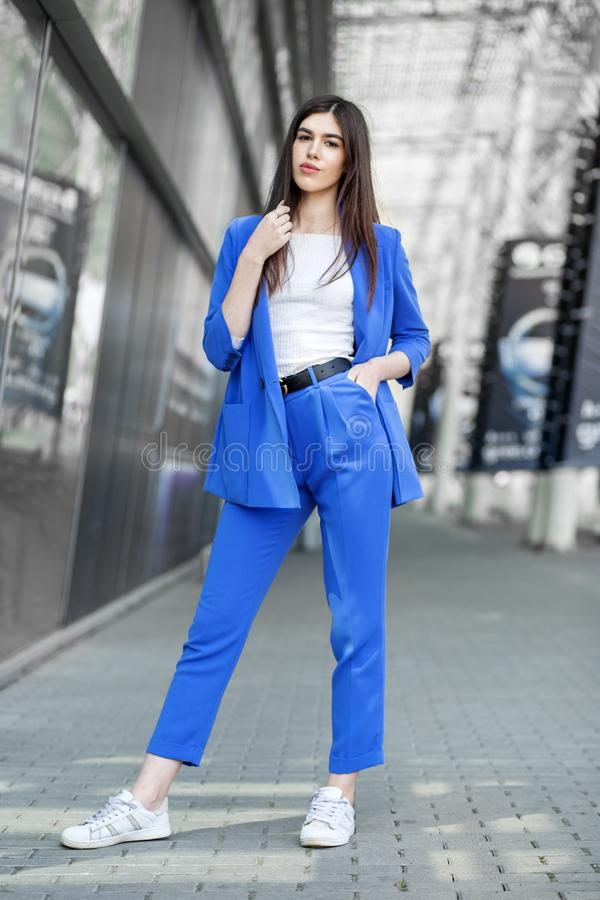 Beautiful brunette model posing in blue clothes. The concept of fashion, beauty, shopping and lifestyle stock photos
