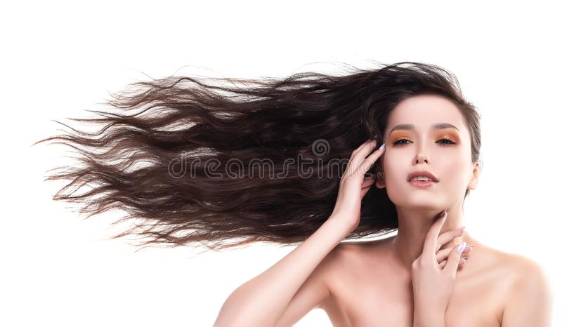 Beautiful brunette naked shoulders girl with flying horizontally royalty free stock images