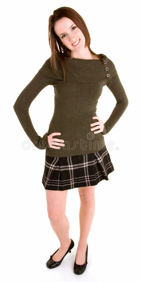 Download Beautiful Brunette In A Plaid Skirt And Sweater Stock Photo - Image: 4393078