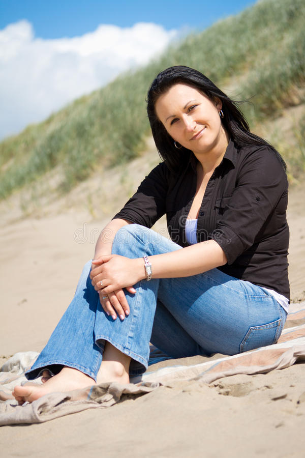 Beautiful Brunette Portrait On The Beach Royalty Free Stock Image