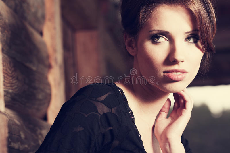 Beautiful brunette posing stock photography