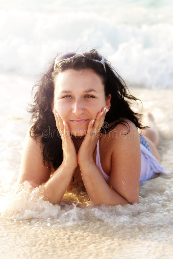 Download Beautiful Brunette Posing On The Beach Stock Photo - Image of holiday, ocean: 24686202