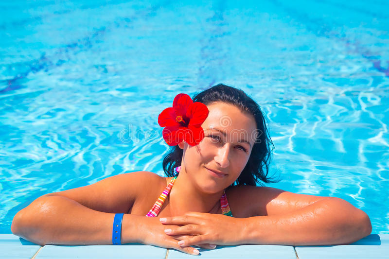 Download Beautiful Brunette Relaxing At Swimming Pool Stock Photo - Image: 32909394