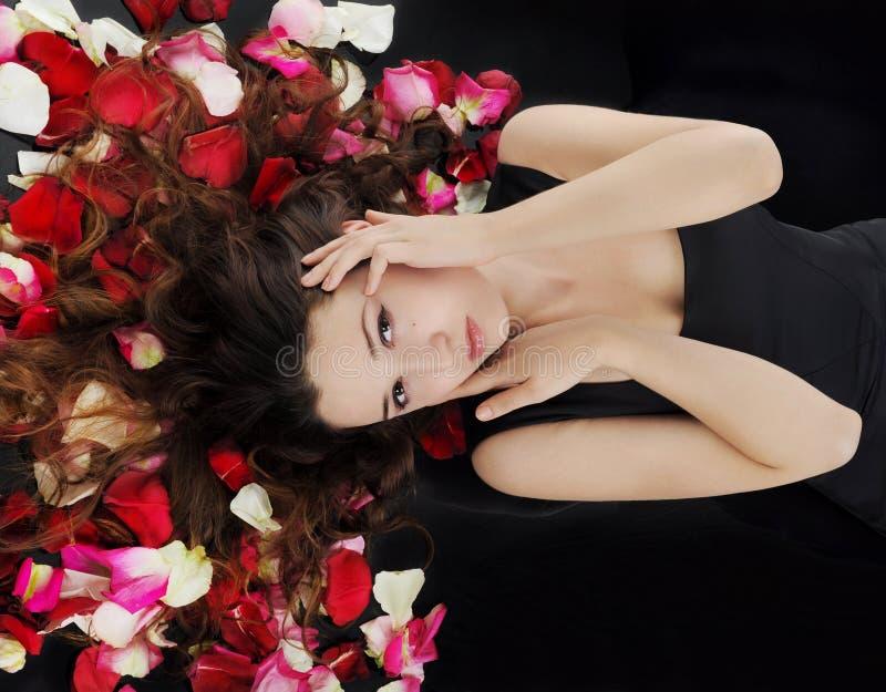 Download Beautiful Brunette In Rose Petals Stock Photo - Image: 16862752