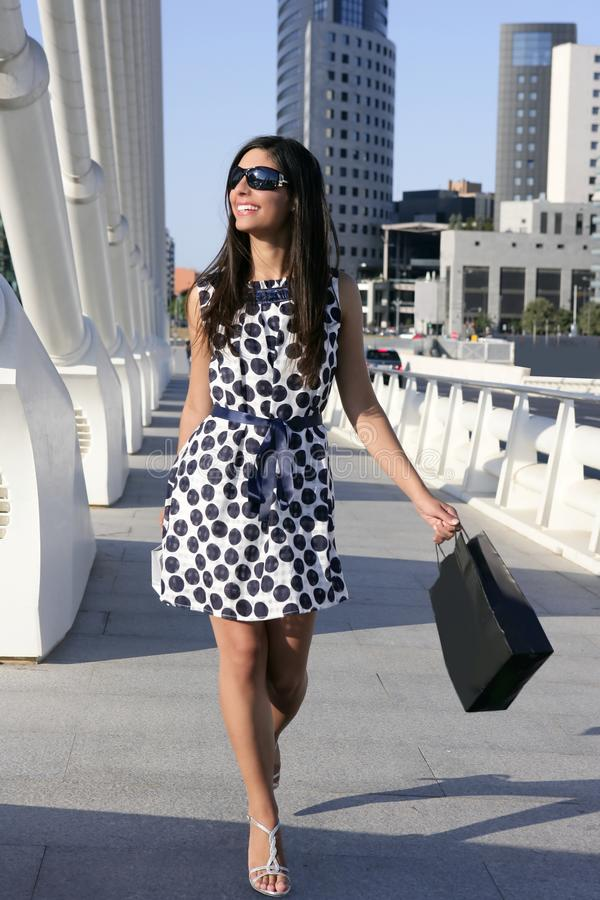 Beautiful brunette shopaholic outdoor city stock image