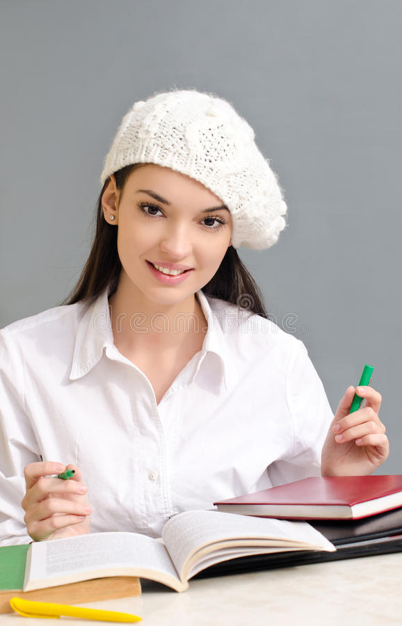 Beautiful student girl wearing a beret. royalty free stock photography