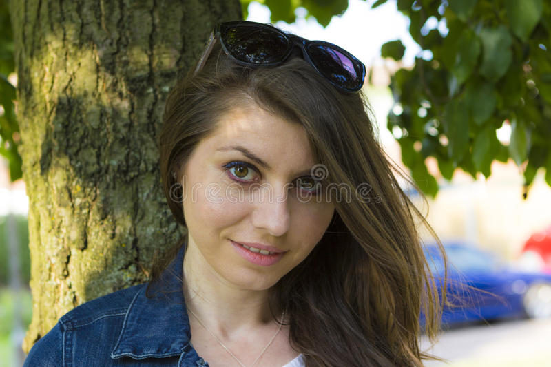 Beautiful brunette in summer park royalty free stock photo