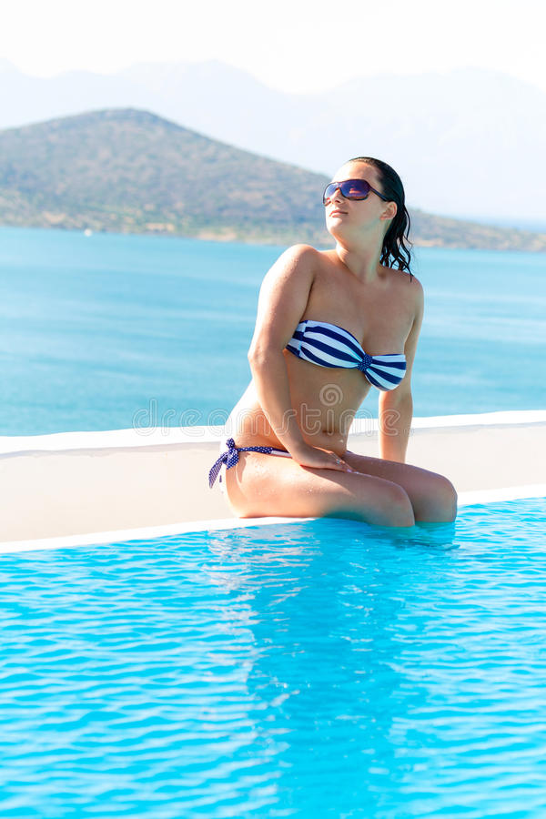 Download Beautiful Brunette At Sunny Swimming Pool Stock Photo - Image: 28744730