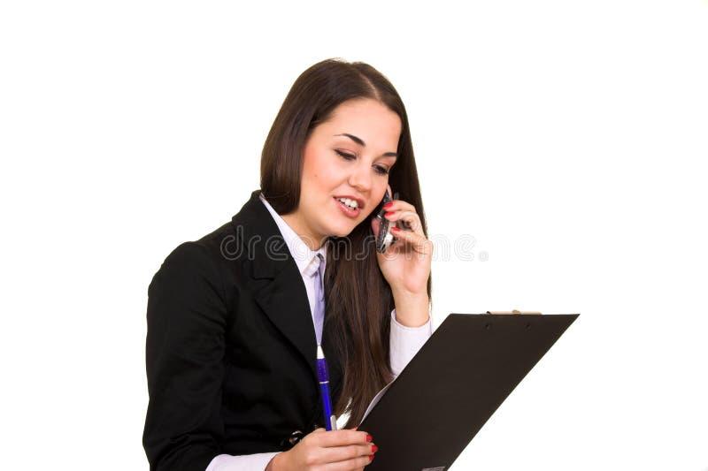 Beautiful brunette talking on mobile phone stock image