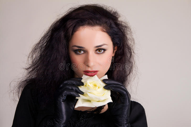Download Beautiful Brunette With A White Rose's Bud Royalty Free Stock Photo - Image: 13062725