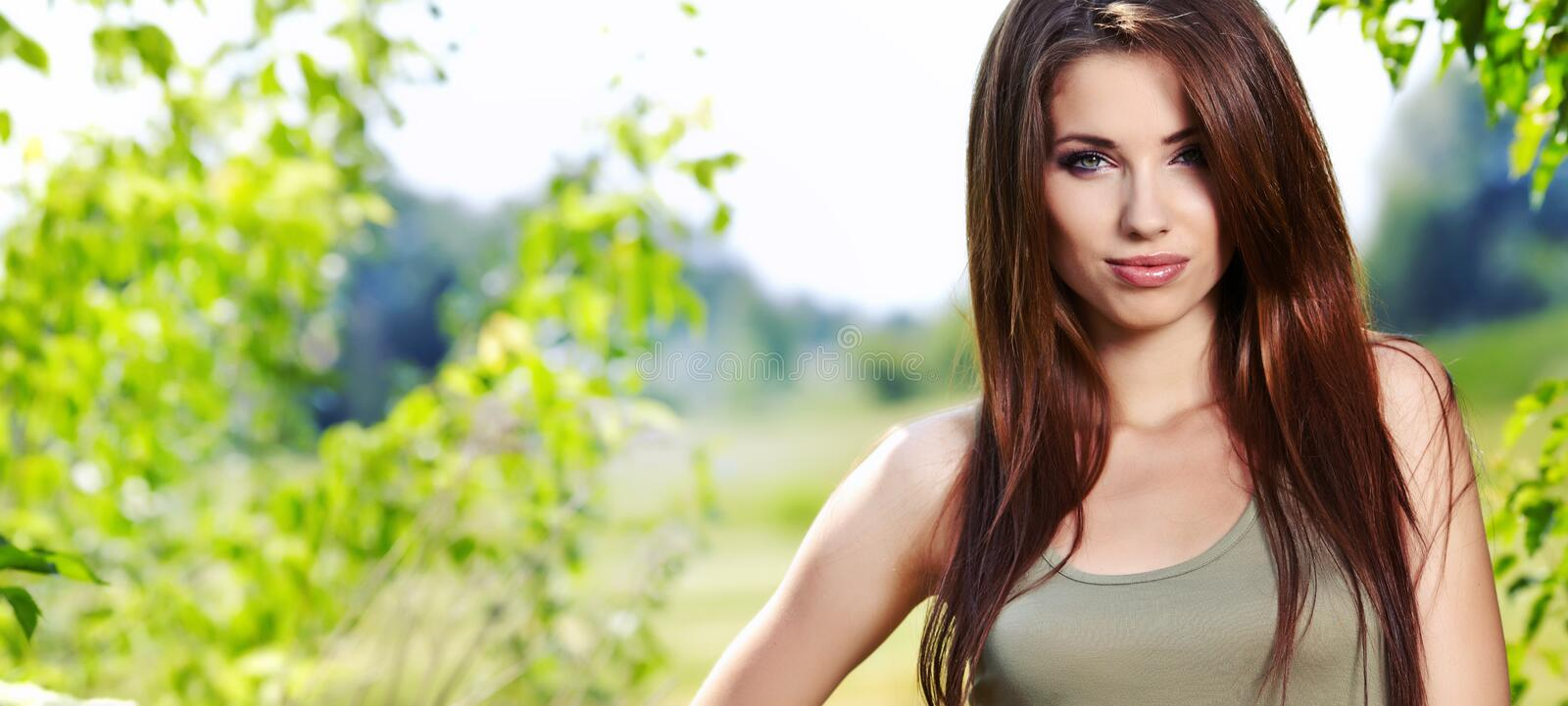 Beautiful brunette woman stock photos