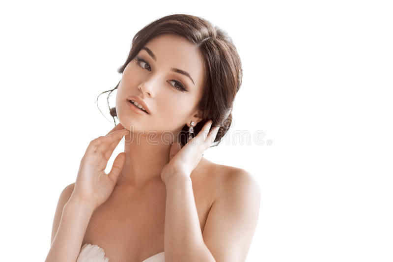 Beautiful brunette woman as bride on white background royalty free stock images