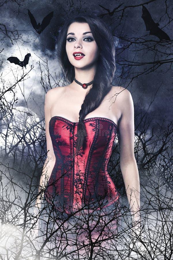 Beautiful brunette woman as vampire. Halloween portrait stock photos
