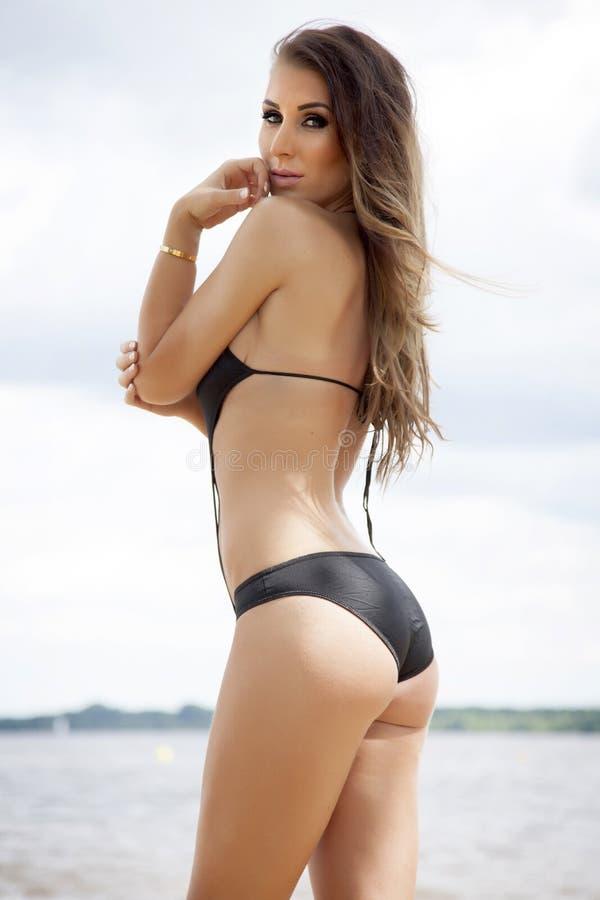 Beautiful brunette woman in bikini royalty free stock images