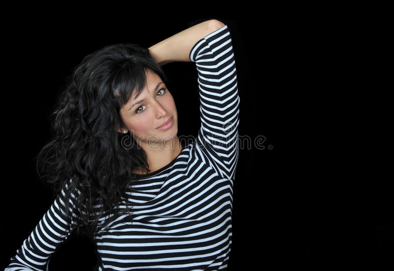 Beautiful brunette woman on a black background. royalty free stock photography