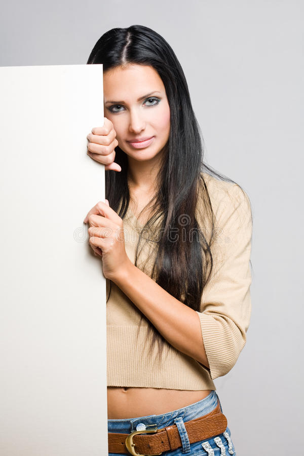 Beautiful brunette woman with blank sheet. stock images