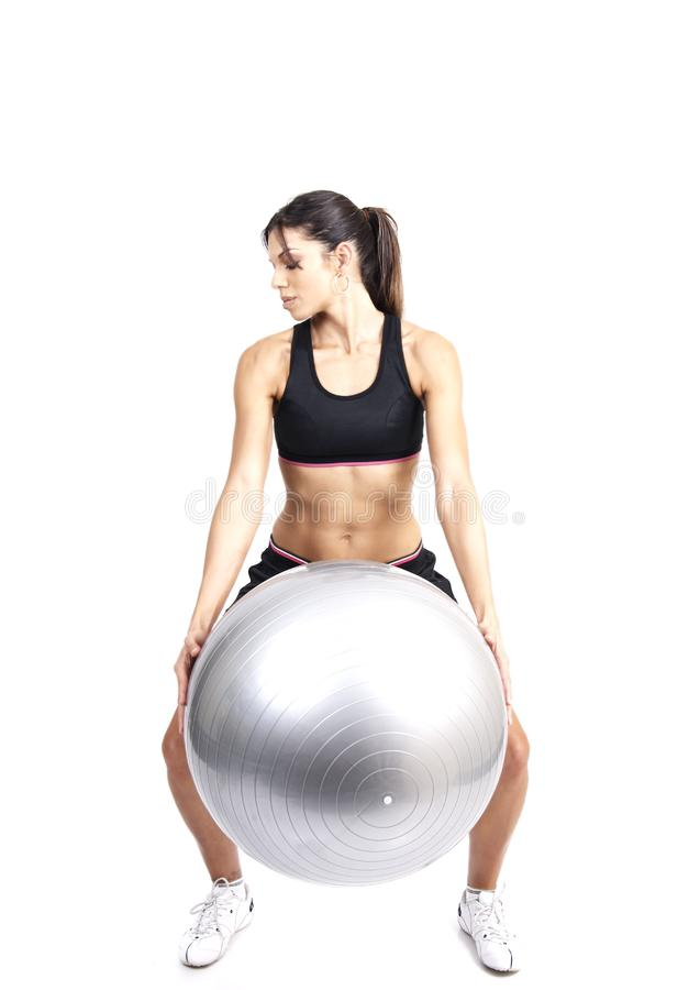 Beautiful brunette woman exercising royalty free stock photography