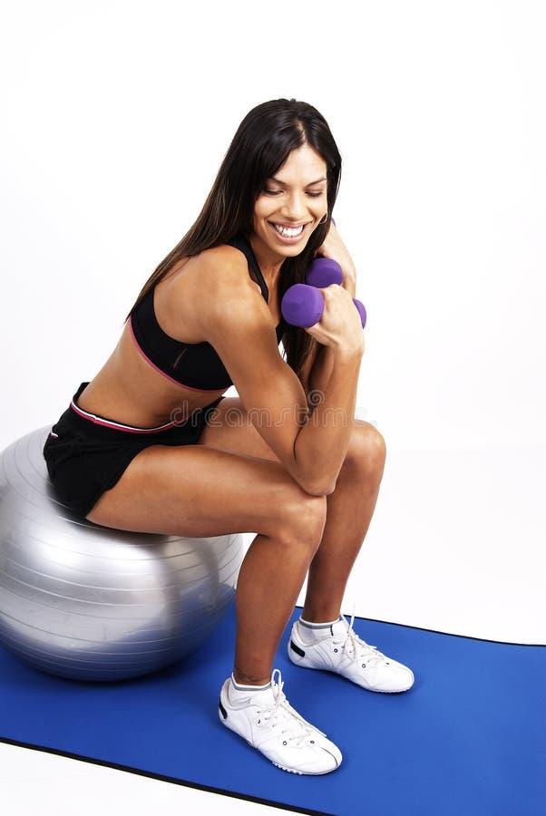 Beautiful brunette woman exercising royalty free stock photo