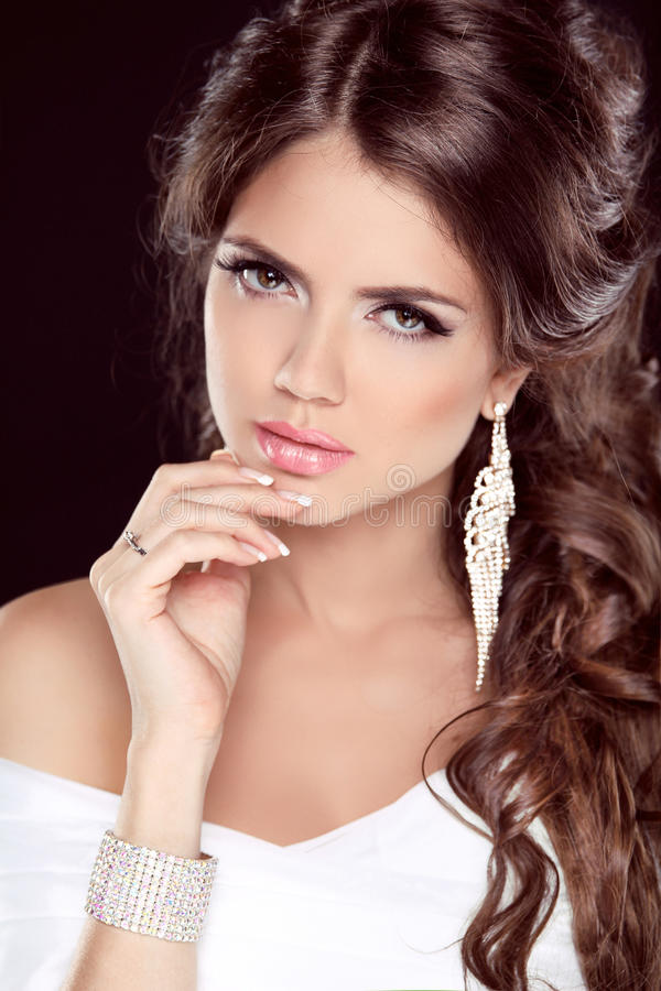 Beautiful Brunette Woman. Hairstyle. Makeup. Manicured nails. Fa stock photos