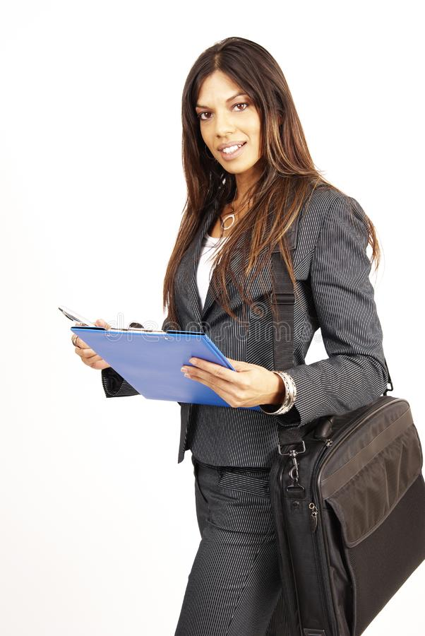 Beautiful brunette woman holding a clipboard royalty free stock photography