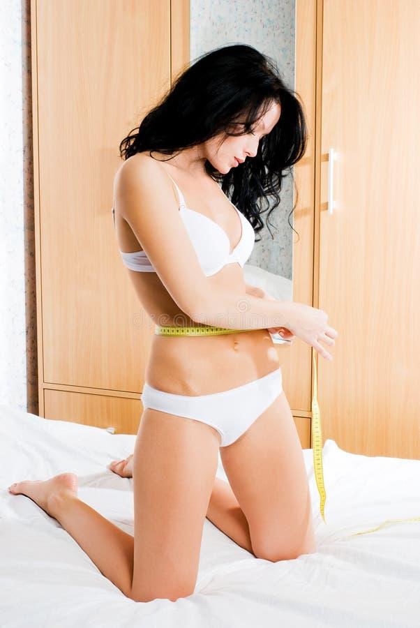 Download Beautiful Brunette Woman Measuring Her Waist Stock Photo - Image of beauty, beautiful: 7233598