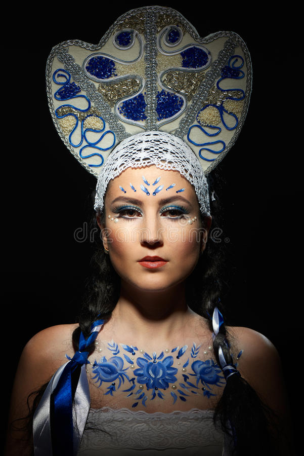 Beautiful brunette woman in national costume stock images