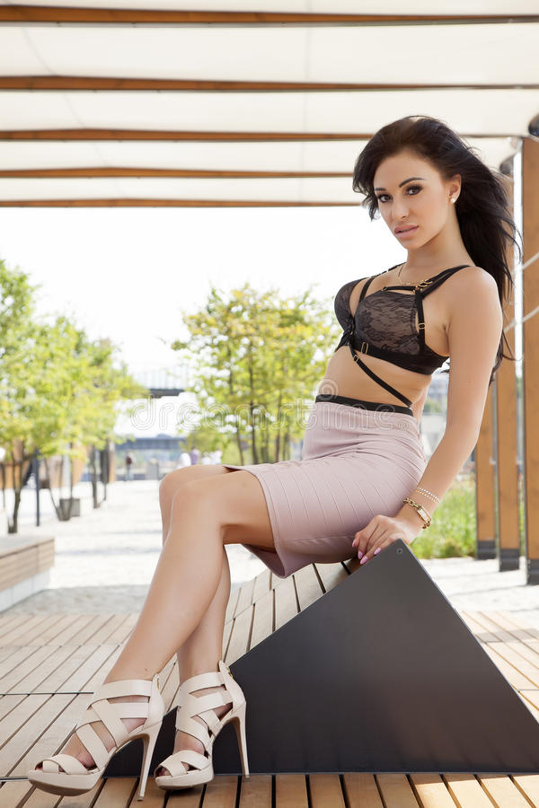Beautiful brunette woman on outdoor. Portrait of a young adult attractive and sensuality pretty beautiful brunette woman on the outdoor city stock photo