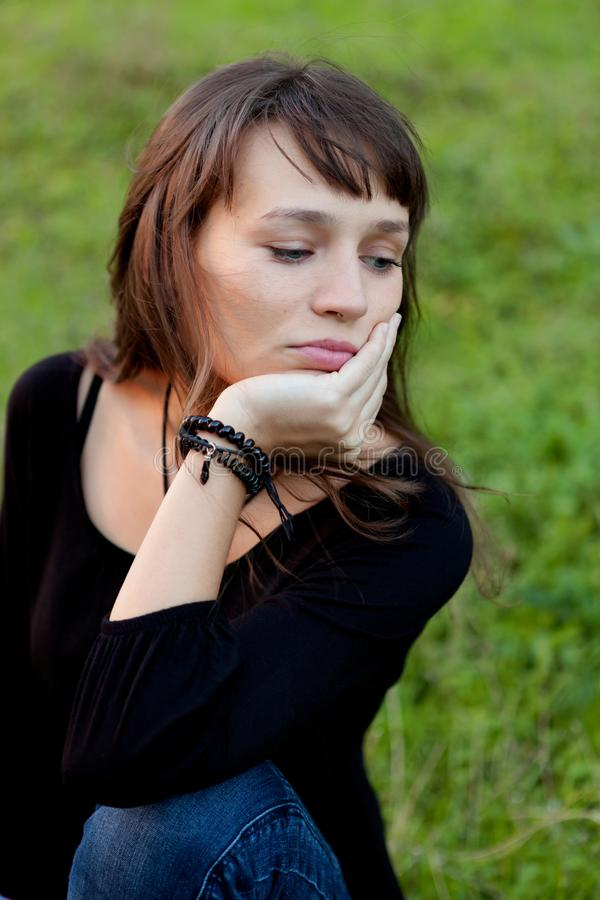 Beautiful brunette woman in the park royalty free stock photos