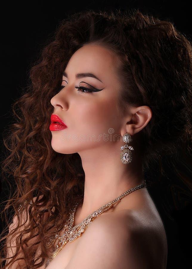 Beautiful Brunette Woman Portrait. Over Dark Background stock photo