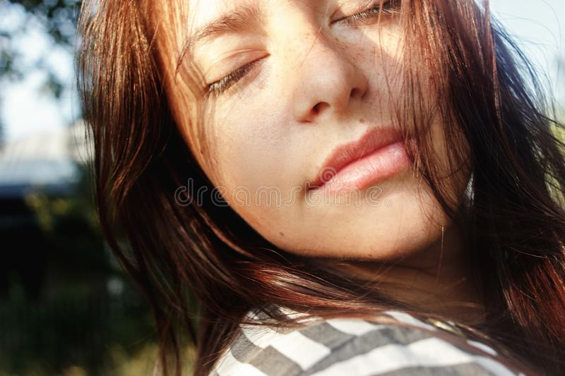 Beautiful brunette woman portrait with relaxed calm emotions in royalty free stock images